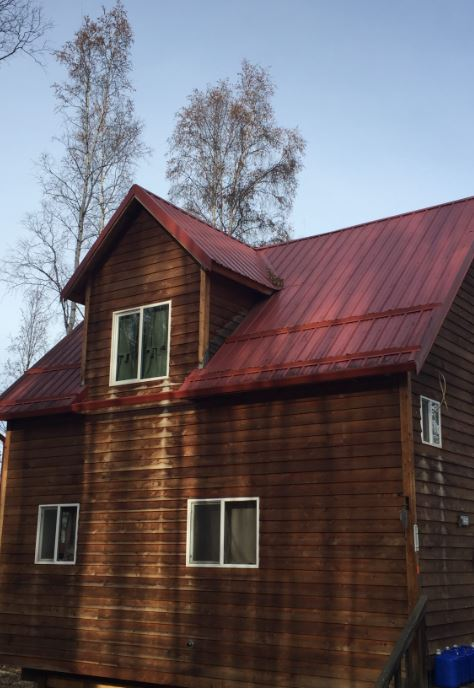 Log home gutter and metal roofing